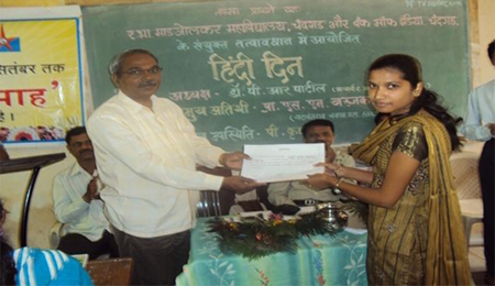 ESSAY COMPETITION   First  prize  winner (prize distribution)